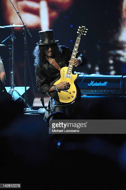 Inductee Slash of Guns N' Roses performs onstage during the 27th Annual Rock And Roll Hall of Fame Induction Ceremony at Public Hall on April 14 2012...