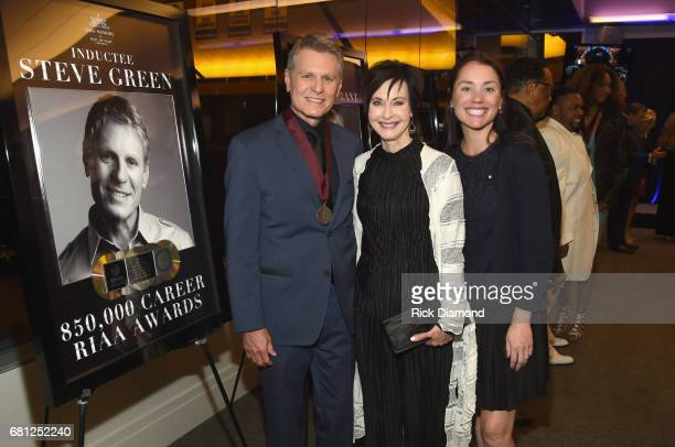 Inductee Steve Green Marijean McCarly and VP at RIAA Communications Liz Kennedy take photos with his award at the GMA Honors on May 9 2017 in...