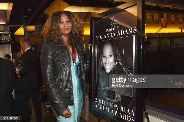 Inductee Yolanda Adams takes photos with her award at the GMA Honors on May 9 2017 in Nashville Tennessee