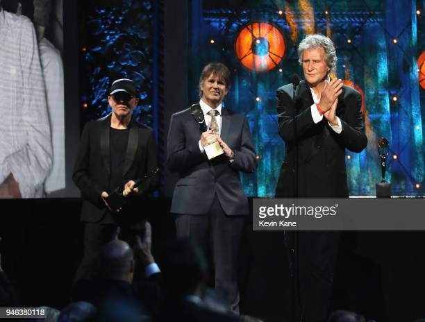 Inductees Alan Clark Guy Fletcher and John Illsley of Dire Straits attend the 33rd Annual Rock Roll Hall of Fame Induction Ceremony at Public...