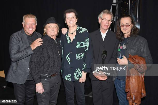 Inductees Alex Lifeson Alan White Trevor Rabin Bill Bruford and Geddy Lee attend the Press Room of the 32nd Annual Rock Roll Hall Of Fame Induction...