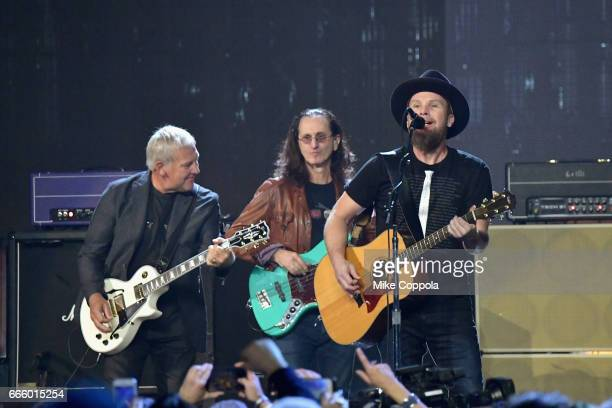 Inductees Alex Lifeson and Geddy Lee of Rush and 2017 Inductee Jeff Ament of Pearl Jam perform onstage at the 32nd Annual Rock Roll Hall Of Fame...