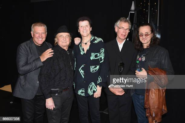 Inductees Alex Lifeson and Geddy Lee of Rush and 2017 Inductees Trevor Rabin Alan White and Bill Bruford of Yes attend the Press Room of the 32nd...