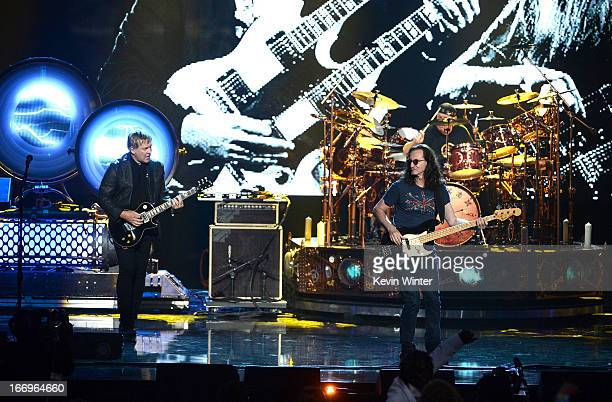 Inductees Alex Lifeson and Geddy Lee of Rush perform on stage at the 28th Annual Rock and Roll Hall of Fame Induction Ceremony at Nokia Theatre LA...