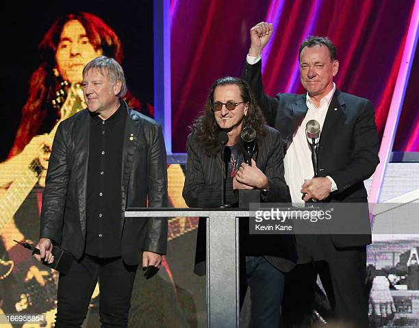 Inductees Alex Lifeson Geddy Lee and Neil Peart of Rush speak onstage during the 28th Annual Rock and Roll Hall of Fame Induction Ceremony at Nokia...
