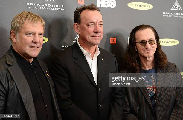 Inductees Alex Lifeson Neil Peart and Geddy Lee of Rush arrive at the 28th Annual Rock and Roll Hall of Fame Induction Ceremony at Nokia Theatre LA...