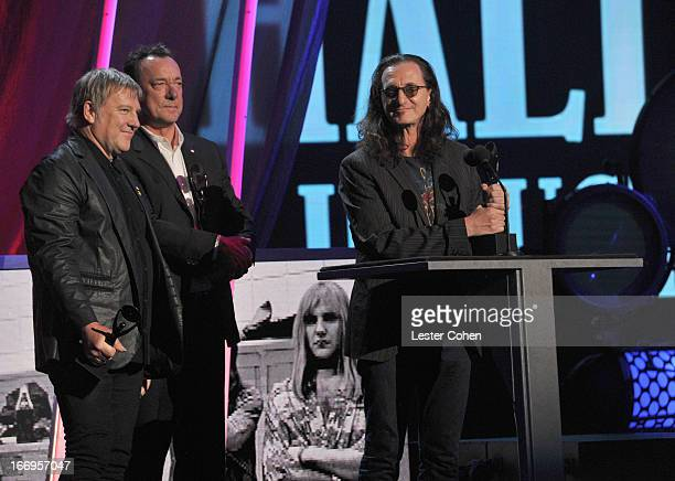 Inductees Alex Lifeson Neil Peart and Geddy Lee of Rush speak onstage during the 28th Annual Rock and Roll Hall of Fame Induction Ceremony at Nokia...