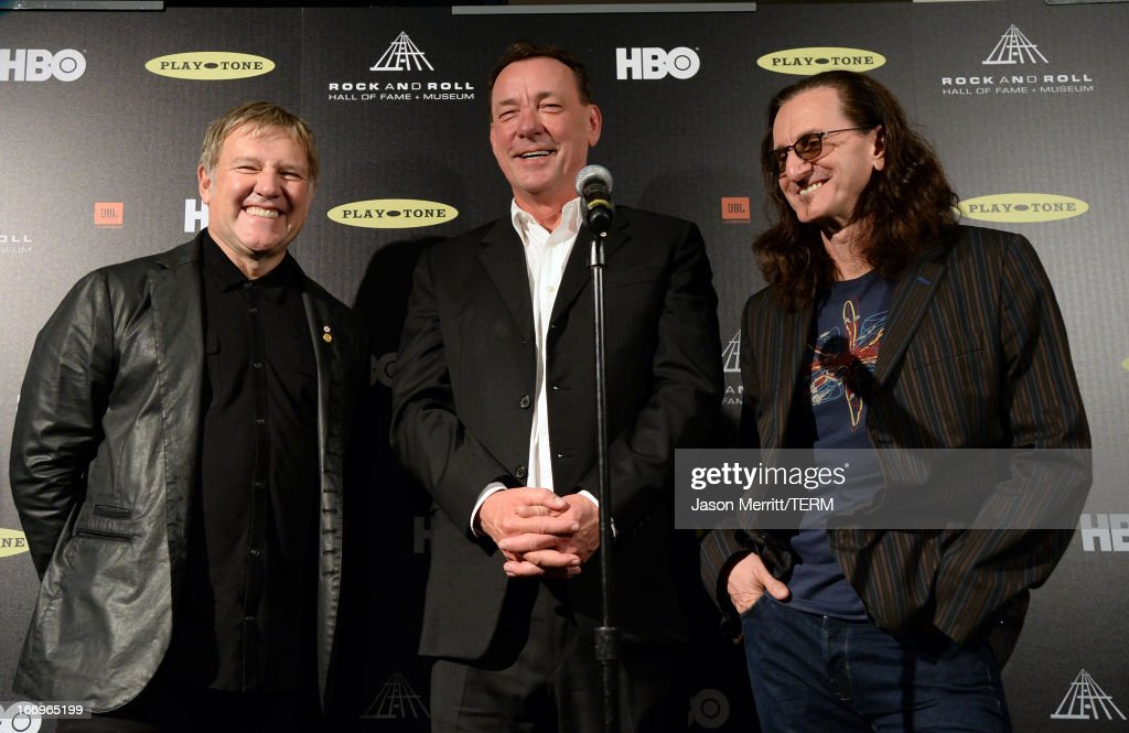 Inductees Alex Lifeson, Neil Peart, and Geddy Lee pose in the press room at the 28th Annual Rock and Roll Hall of Fame Induction Ceremony at Nokia Theatre L.A. Live on April 18, 2013 in Los Angeles, California.