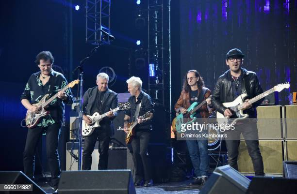 Inductees Alex Lifeson Trevor Rabin Mike McCready Jeff Ament and presenter Dhani Harrison perform onstage at the 32nd Annual Rock Roll Hall Of Fame...