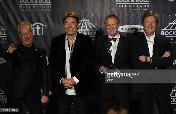 Inductees Chicago band members James Pankow Walter Parazaider Lee Loughnane and Robert Lamm pose in the press room during the 31st Annual Rock and...