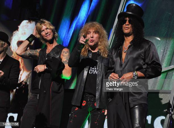 Inductees Duff McKagan Steven Adler and Slash of Guns N' Roses speak on stage during the 27th Annual Rock And Roll Hall Of Fame Induction Ceremony at...