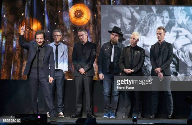 Inductees Eddie Vedder Dave Krusen Stone Gossard Jeff Ament Mike McCready and Matt Cameron of Pearl Jam speak onstage at the 32nd Annual Rock Roll...