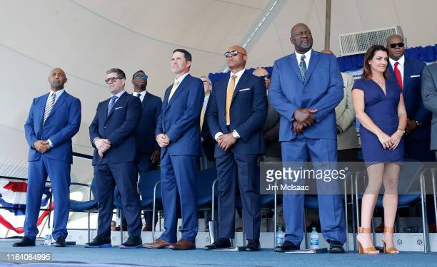 Inductees Harold Baines Edgar Martinez Mike Mussina Mariano Rivera Lee Smith and Brandy Halladay representing the late Roy Halladay look on during...