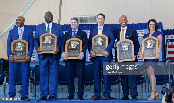 Inductees Harold Baines Lee Smith Edgar Martinez Mike Mussina Mariano Rivera and Brandy Halladay wife the late Roy Halladay pose with their plaques...