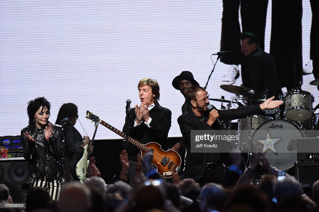 Inductees Joan Jett and Ringo Starr perform with Paul McCartney onstage during the 30th Annual Rock And Roll Hall Of Fame Induction Ceremony at Public Hall on April 18, 2015 in Cleveland, Ohio.