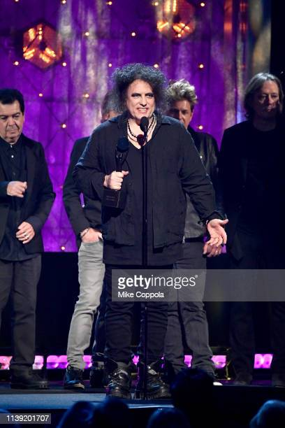 Inductees Lol Tolhurst Robert Smith Jason Cooper and Roger O'Donnell of The Cure speak onstage at the 2019 Rock Roll Hall Of Fame Induction Ceremony...