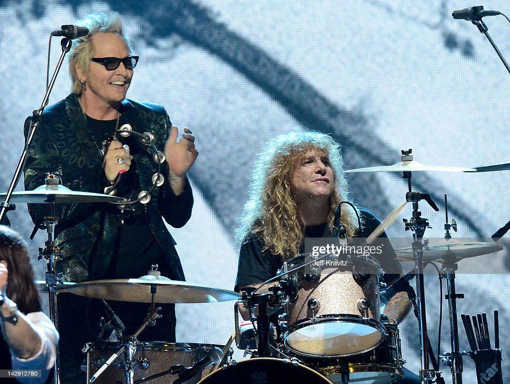 Inductees Matt Sorum (L) and Steven Adler (R) of Guns N' Roses perform on stage at the 27th Annual Rock And Roll Hall Of Fame Induction Ceremony at Public Hall on April 14, 2012 in Cleveland, Ohio.