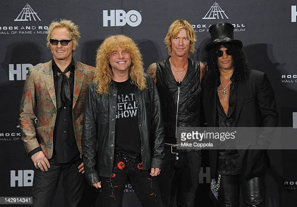 Inductees Matt Sorum, Steven Adler, Duff McKagan and Slash of Guns N' Roses pose in the press room during the 27th Annual Rock And Roll Hall of Fame...