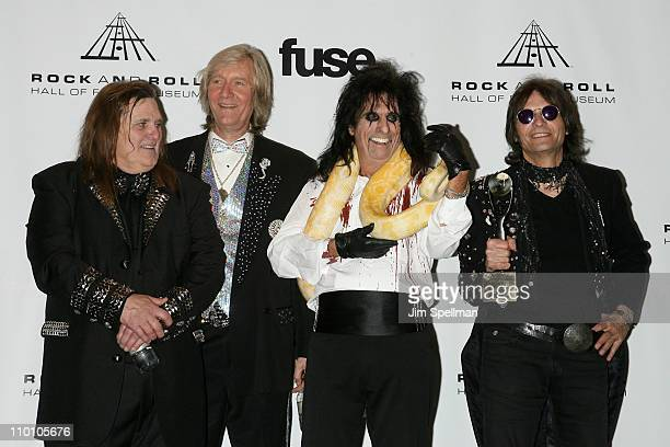 Inductees Michael Bruce Neal Smith Alice Cooper and Dennis Dunaway of The Alice Cooper Band pose at the 26th annual Rock and Roll Hall of Fame...