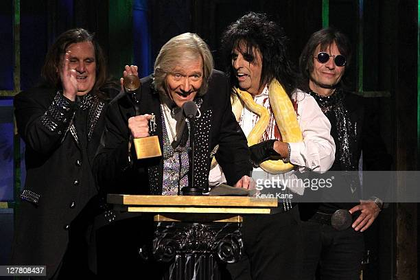 Inductees Michael Bruce Neal Smith Alice Cooper and Dennis Dunaway of The Alice Cooper Band speak onstage at the 26th annual Rock and Roll Hall of...