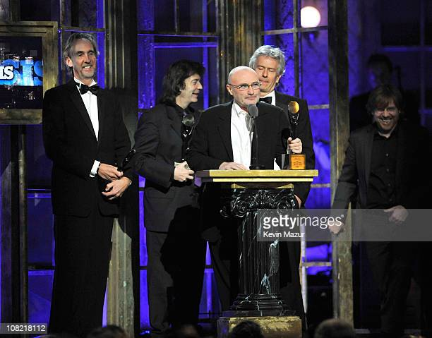 Inductees Mike Rutherford Steve Hackett Phil Collins and Tony Banks of Genesis speak onstage at the 25th Annual Rock and Roll Hall of Fame Induction...