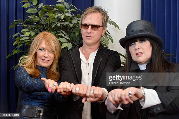 Inductees Nancy Wilson and Ann Wilson of Heart with musician Jerry Cantrell of Alice in Chains attend the 28th Annual Rock and Roll Hall of Fame...