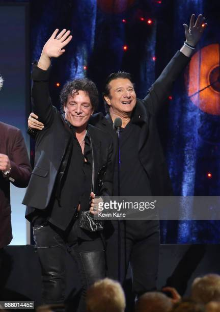 Inductees Neal Schon and Steve Perry of Journey onstage at the 32nd Annual Rock Roll Hall Of Fame Induction Ceremony at Barclays Center on April 7...