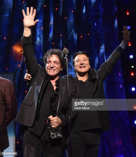 Inductees Neal Schon and Steve Perry of Journey speak onstage during the 32nd Annual Rock Roll Hall Of Fame Induction Ceremony at Barclays Center on...