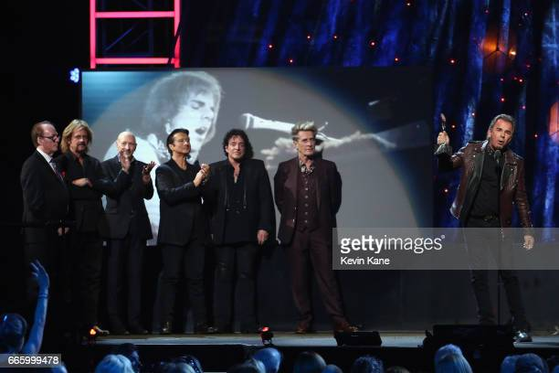 Inductees Neal Schon Bill Bruford Steve Smith Gregg Rolie Steve Perry Ross Valory and Jonathan Cain of Journey speak onstage at the 32nd Annual Rock...