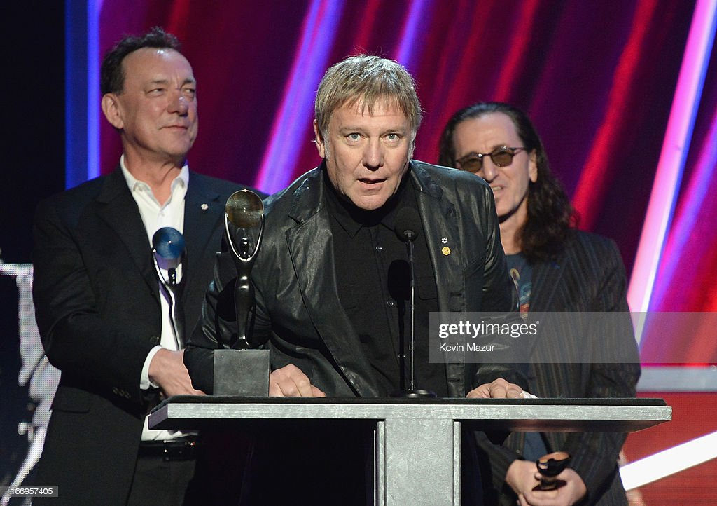 Inductees Neil Peart, Alex Lifeson and Geddy Lee speak onstage during the 28th Annual Rock and Roll Hall of Fame Induction Ceremony at Nokia Theatre L.A. Live on April 18, 2013 in Los Angeles, California.