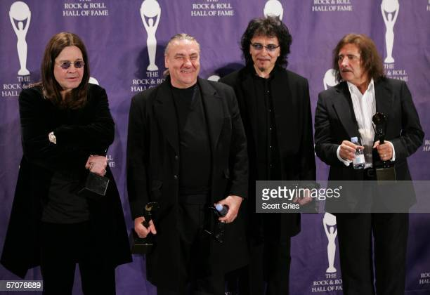 Inductees Ozzy Osbourne Bill Ward Tony Iommi and Terry Butler of Black Sabbath pose backstage during the 21st Annual Rock And Roll Hall Of Fame...