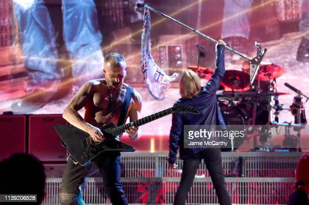 Inductees Phil Collen and Joe Elliott of Def Leppard perform at the 2019 Rock & Roll Hall Of Fame Induction Ceremony - Show at Barclays Center on...