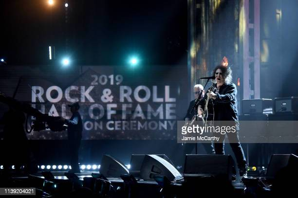 Inductees Reeves Gabrels and Robert Smith of The Cure performs onstage at at the 2019 Rock Roll Hall Of Fame Induction Ceremony Show at Barclays...