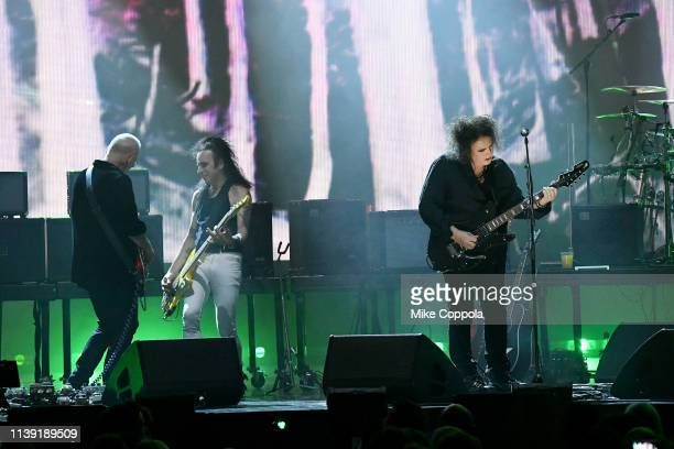 Inductees Reeves Gabrels Simon Gallup and Robert Smith of The Cure perform at the 2019 Rock Roll Hall Of Fame Induction Ceremony Show at Barclays...