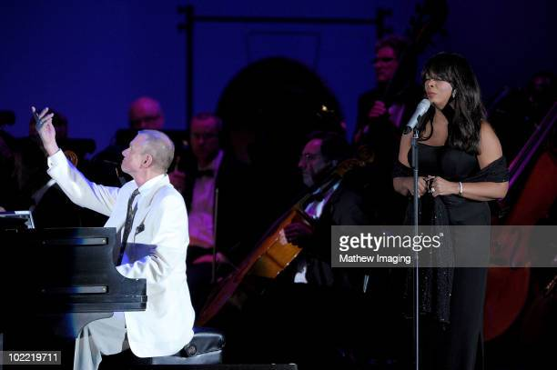 Inductees Richard Carpenter of The Carpenters and Donna Summer on stage during the Hollywood Bowl Opening Night Gala held at the Hollywood Bowl on...