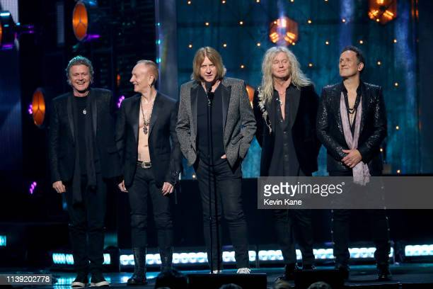 Inductees Rick Allen Phil Collen Joe Elliott Rick Savage and Vivian Campbell of Def Leppard speak onstage during the 2019 Rock Roll Hall Of Fame...