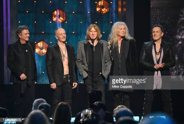 Inductees Rick Allen, Phil Collen, Joe Elliott, Rick Savage and Vivian Campbell of Def Leppard speak onstage during the 2019 Rock & Roll Hall Of Fame...