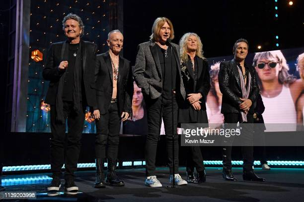 Inductees Rick Allen, Phil Collen, Joe Elliott, Rick Savage, and Vivian Campbell of Def Leppard speak at the 2019 Rock & Roll Hall Of Fame Induction...