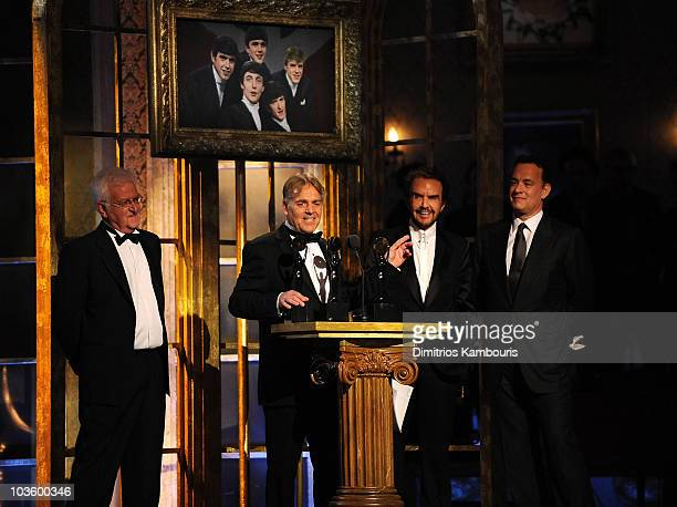 Inductees Rick Huxley, Lenny Davidson and Dave Clark of The Dave Clark Five with actor Tom Hanks on stage during the 23rd Annual Rock and Roll Hall...