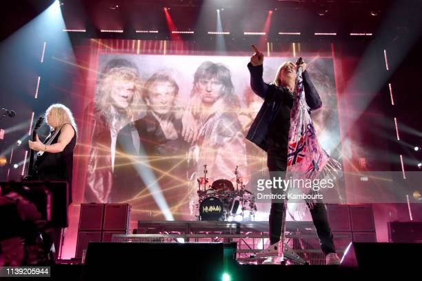 Inductees Rick Savage and Joe Elliott of Def Leppard perform at the 2019 Rock & Roll Hall Of Fame Induction Ceremony - Show at Barclays Center on...