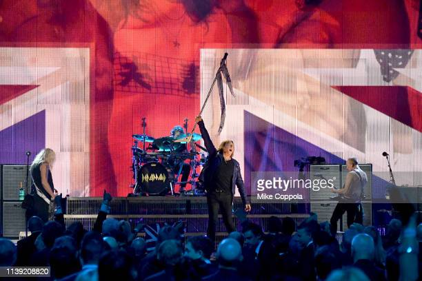 Inductees Rick Savage, Rick Allen, Joe Elliott, and Phil Collen of Def Leppard perform at the 2019 Rock & Roll Hall Of Fame Induction Ceremony - Show...