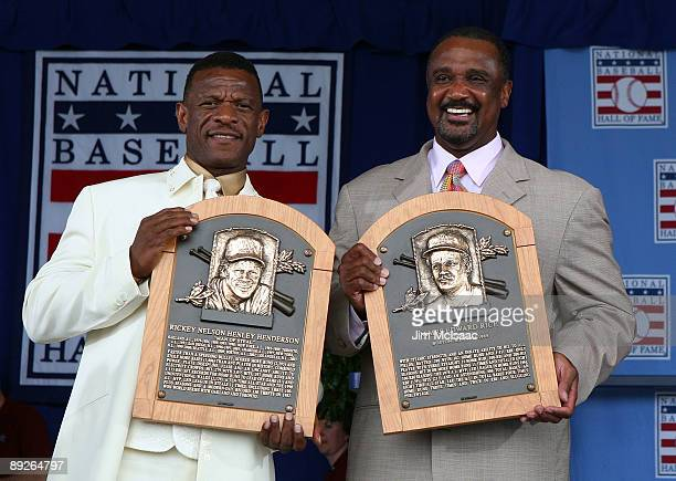 2009 inductees Rickey Henderson and Jim Rice pose for a photograph with their plaques at Clark Sports Center during the Baseball Hall of Fame...