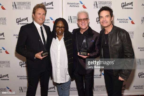 Inductees Robert Lamm and James Pankow pose with Whoopi Goldberg and Pat Monahan backstage at the Songwriters Hall Of Fame 48th Annual Induction and...