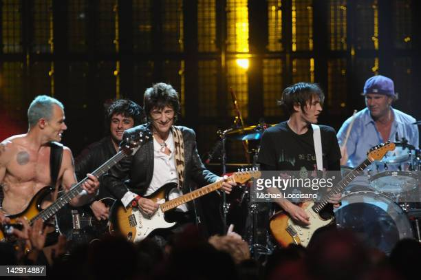 Inductees Ron Wood Flea Chad Smith Josh Klinghoffer perform with Billie Joe Armstrong onstage during the 27th Annual Rock And Roll Hall of Fame...