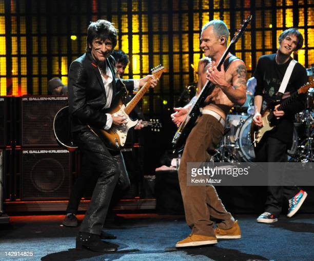 Inductees Ron Wood of Faces and Flea of The Red Hot Chilli Peppers perform on stage at the 27th Annual Rock And Roll Hall Of Fame Induction Ceremony...