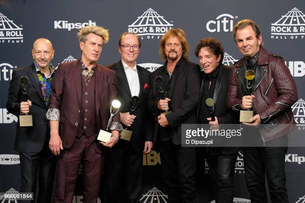 Inductees Steve Smith Ross Valory Aynsley Dunbar Gregg Rolie Neal Schon and Jonathan Cain of Journey attend the Press Room of the 32nd Annual Rock...