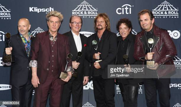 2017 Inductees Steve Smith Ross Valory Aynsley Dunbar Gregg Rolie Neal Schon and Jonathan Cain of Journey attend the Press Room of the 32nd Annual...