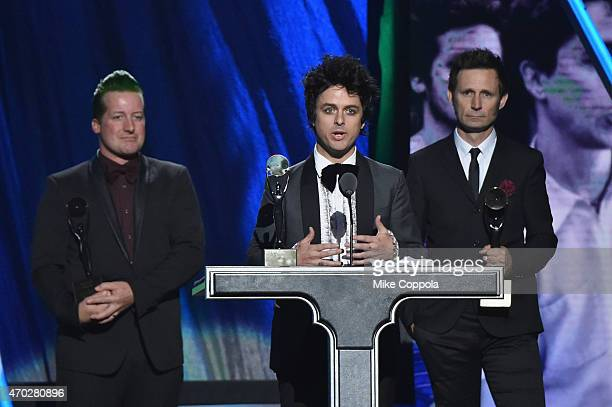 Inductees Tre Cool Billie Joe Armstrong and Mike Dirnt of Green Day speak onstage during the 30th Annual Rock And Roll Hall Of Fame Induction...