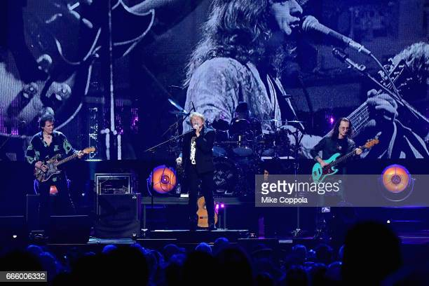 Inductees Trevor Rabin Alan White and Jon Anderson of Yes and 2013 Geddy Lee of Rush perform onstage at the 32nd Annual Rock Roll Hall Of Fame...