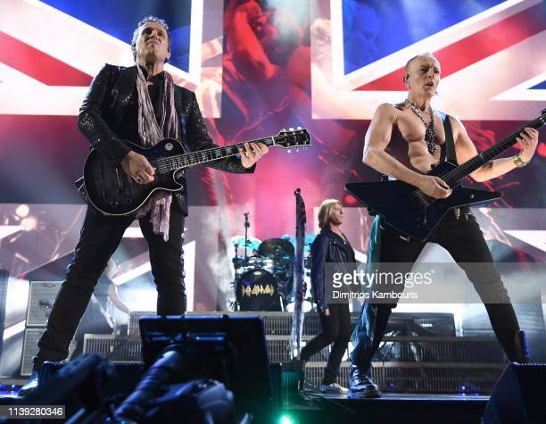 Inductees Vivian Campbell Joe Elliott and Phil Collen of Def Leppard perform at the 2019 Rock Roll Hall Of Fame Induction Ceremony Show at Barclays...